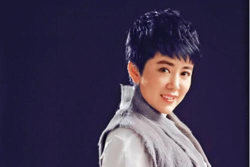 美女首富助朝鲜银行洗黑钱 牵出江泽民 组图