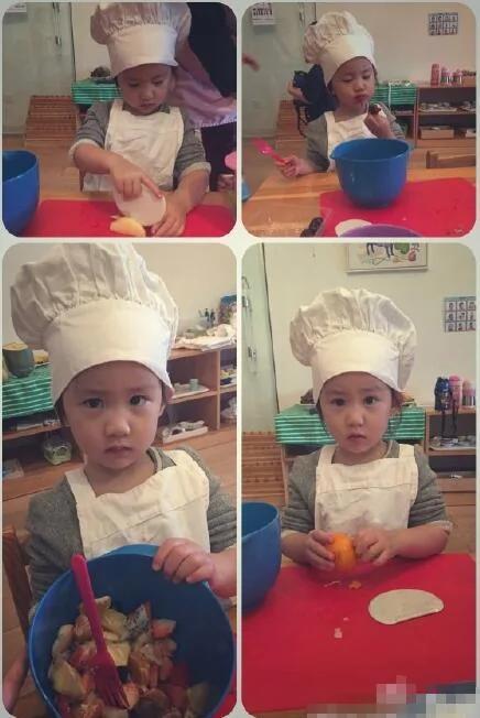 黄磊小女儿戴厨师帽显呆萌专心切水果不时偷吃一口