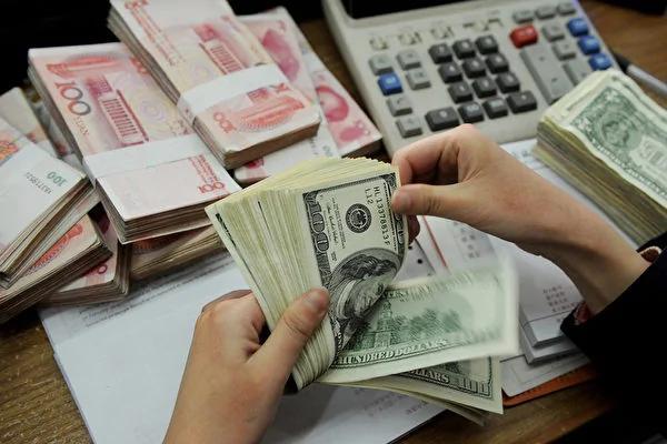 人民币贬值压力大 中国央行突然宣布美元降权