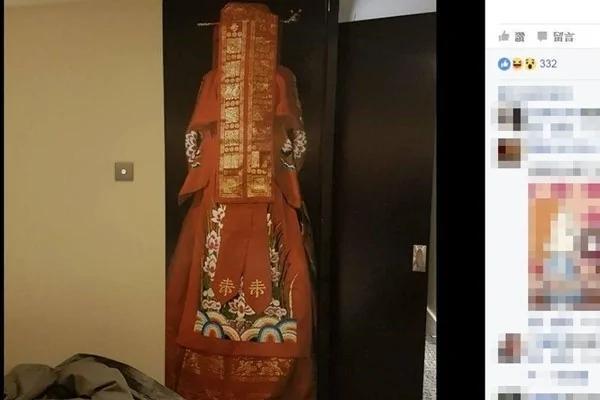 红衣新娘站旁边 英饭店装置艺术让人发毛