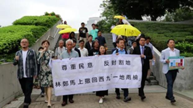 港特首中止辩论印花税让路一地两检 民主派游行抗议